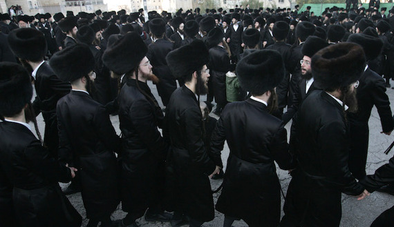 Ultra-Orthodox Jews dance outside a synagogue during a wedding in Jerusalem